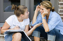 Teenage Daughter Arguing With Mother on Porch